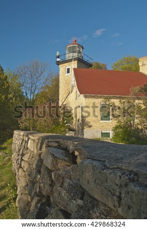 Eagle Bluff Lighthouse is located in Peninsula State Park in Door County, Wisconsin, and shown here in late afternoon light in Spring - stock photo