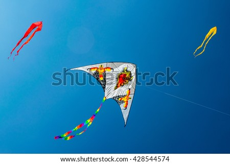 Eagle-kite hovering in the blue sky at kite festival in Moscow