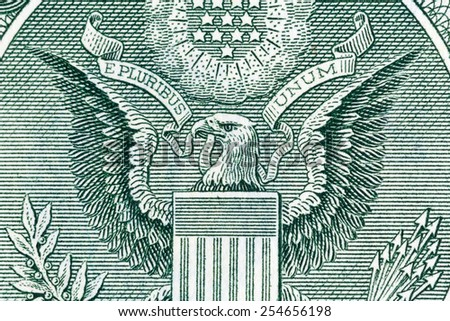 Eagle on one U.S. dollar bill, close-up photo. - stock photo