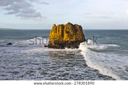 Eagle Rock is a tall volcanic stack capped by limestone located near the Split Point Lighthouse in Victoria, Australia - stock photo