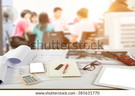 eam of architects working on construction plans - stock photo