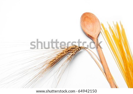 ear of wheat, pasta and wooden spoon