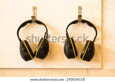 Ear protection hanging on wooden wall