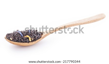 Earl grey tea with calendula, cornflowers, orange peels in the wooden spoon - stock photo