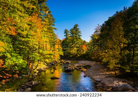 Early autumn color along the Swift River in Conway, New Hampshire. - stock photo