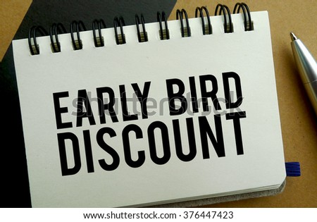Early bird discount memo written on a notebook with pen