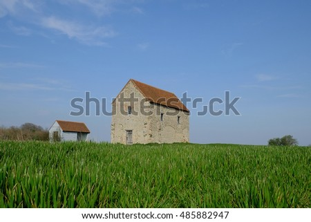 Early cereal crops surround the Chapel of St Peter Ad Murum. Built on the walls of the Roman fort Orthona.