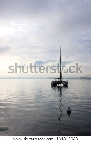 early in the morning in Lake Annecy, with quiet artistic conception