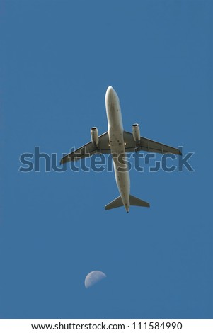 early in the morning, the plane takes off on background blue sky and moon
