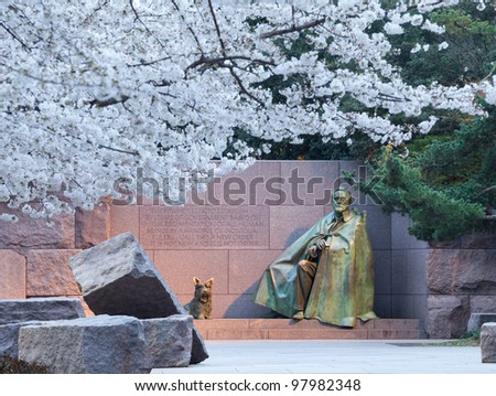 Early Japanese cherry blossoms surround the floodlit monument to Franklin Delano Roosevelt in DC - stock photo