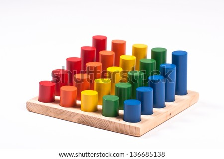 Early Learning Toy: Cylinders of Different Colors and Height - stock photo