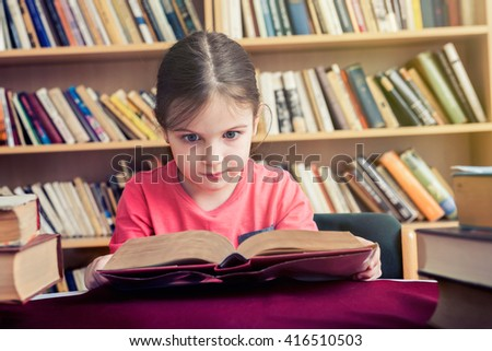 Early Love of Reading - Girl with Books