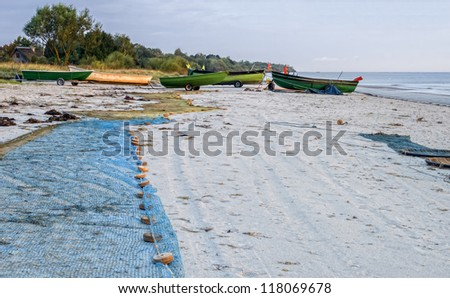 Early morning at a sandy beach near village of fishermen, Baltic Sea, Latvia, Europe - stock photo