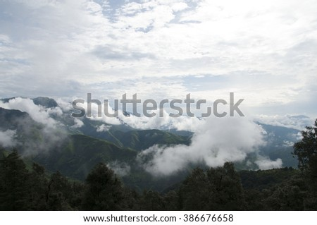 Early morning clouds descending on mountains - stock photo