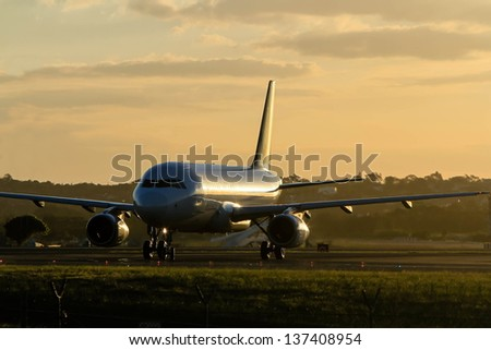 Early morning commercial jet airliner on runway
