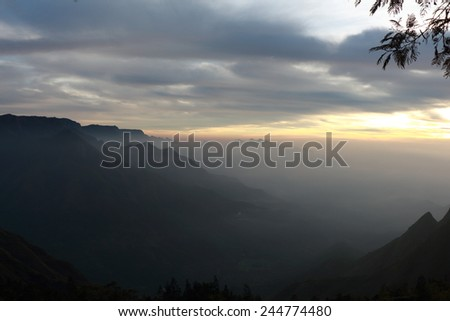 Early morning dusk sky in the Hills of Munnar - stock photo