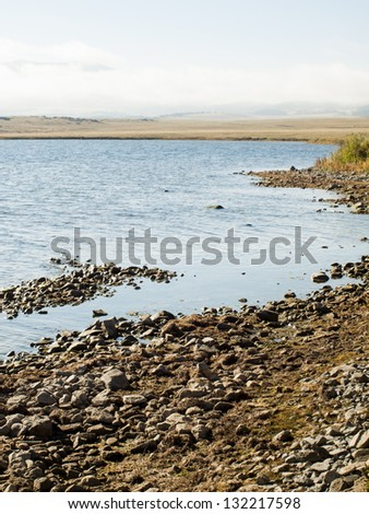 Early morning fishing in Autumn. - stock photo