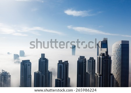Early morning fog is covering Dubai business bay area. - stock photo
