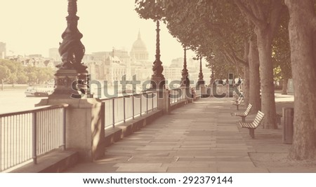 Early morning in Southbank along the Thames in London, looking towards St Pauls with instagram style filter. - stock photo