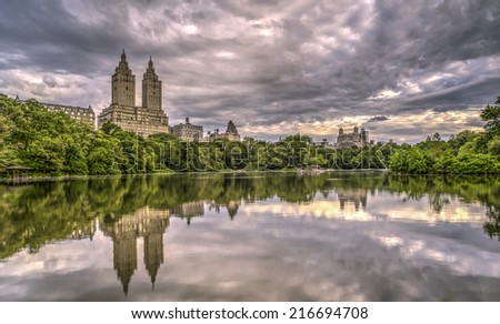 Early morning in spring on cloudy day at the lake  Central Park, New York City - stock photo