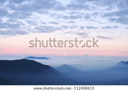 Early morning in the mountains near Sochi. Clouds and fog at sunrise.