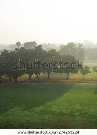 Early morning landscape in fog - stock photo
