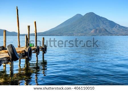 Early morning light on two volcanoes, Atitlan & Toliman, at Lake Atitlan, Guatemala. - stock photo