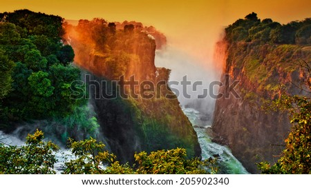 Early morning lights at the Victoria Falls at the border of Zimbabwe and Zambia - stock photo