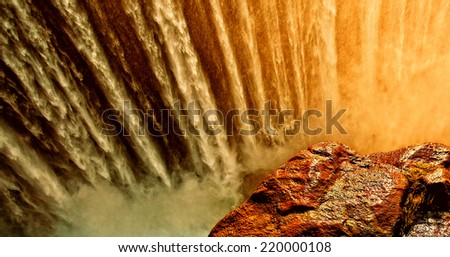 Early morning lights at the Victoria Falls at the border of Zimbabwe and Zambia - stock photo