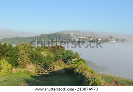 Early morning mist over Salcombe, photographed from East Portlemouth on the South Devon Coast,England,UK - stock photo