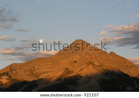 Early morning Montana mountain scene with moon - stock photo
