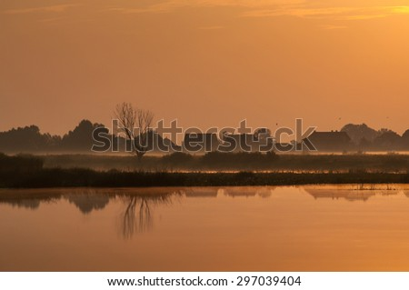 Early morning near the quiet European village near the river in countryside - stock photo