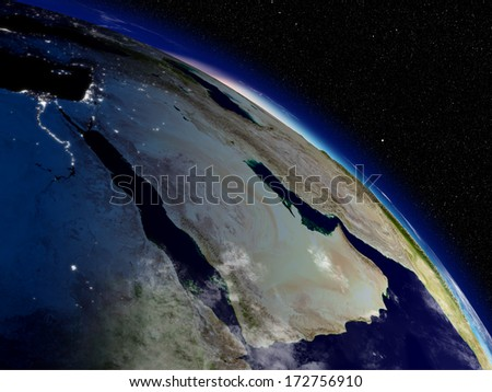 Early morning on Arabian peninsula viewed from space. Highly detailed planet surface with clouds and city lights. Elements of this image furnished by NASA. - stock photo