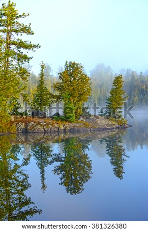 Early Morning on Ottertrack Lake in the Boundary Waters of Minnesota - stock photo