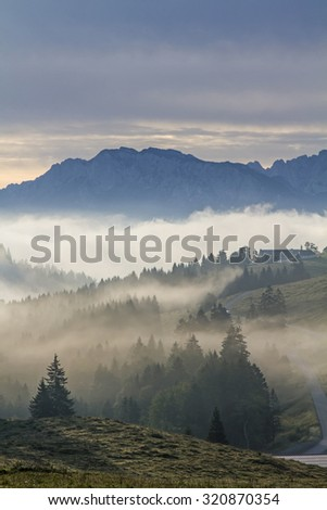Early morning on Sudelfeld - views of the Inn Valley and the Kaiser Mountains - stock photo