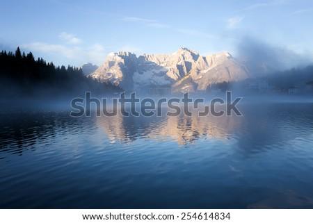 Early morning on the Lake Misurina, Tre Cime Di Lavaredo, Dolomites Alps, Europe. - stock photo