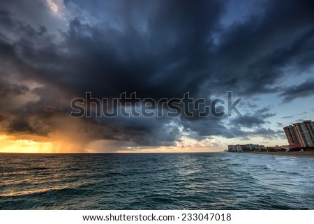 Early morning rainy landscape with rain over Miami Beach, Florida. - stock photo