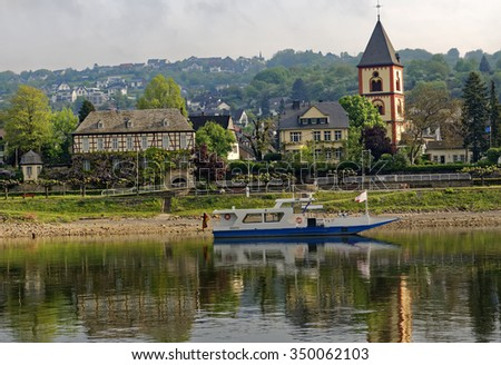 Early morning River Rhine view of a small passenger ferry, which connects the village of Erpel to Remagen on the opposite bank
