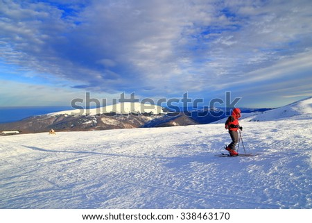 Early morning ski ride on  plateau covered with snow in winter - stock photo