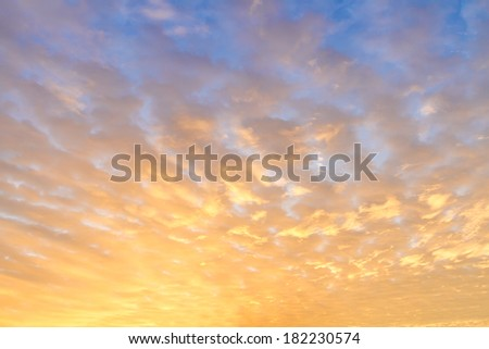 Early morning sky with colors from deep blue to orange. - stock photo