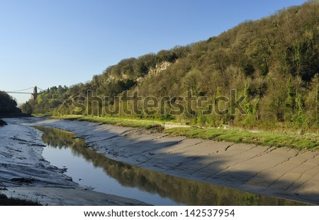 Early morning sun & low water in Avon Gorge with Clifton Suspension Bridge, Bristol - stock photo
