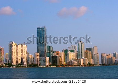 early morning sun on miami florida skyline across biscayne bay