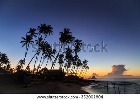Early morning sunrise at the beach in Sri Lanka - stock photo
