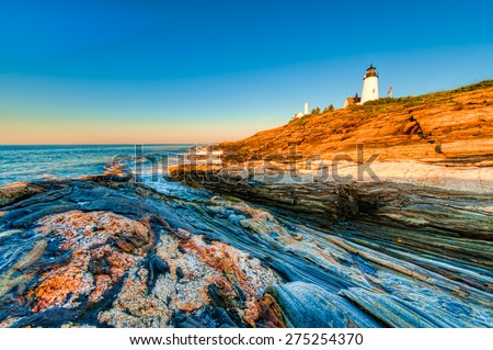 Early morning sunrise at the Pemaquid Point Lighthouse in Maine, USA. - stock photo