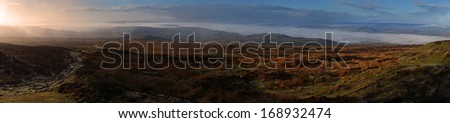 Early morning sunrise on Brown Clee Hill, the highest point in Shropshire, England, UK                             - stock photo