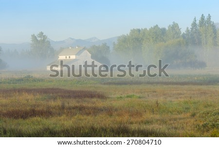 Early morning valley fog around a Montana barn
