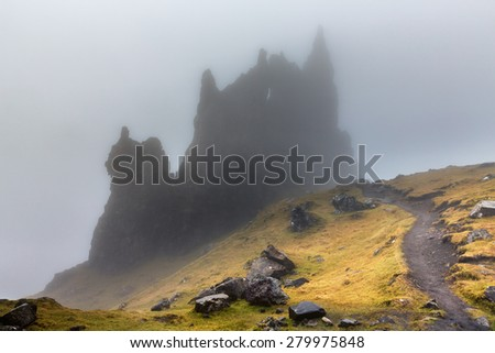 Early morning view and pathway leading to Old Man of Storr on a foggy day, Isle of Skye, Scotland, UK