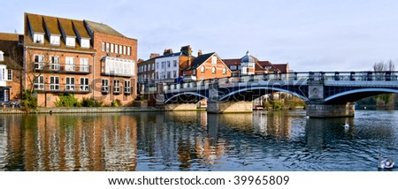 Early morning view downriver  to the old bridge [1842] that connects Windsor and Eton over the River Thames. - stock photo