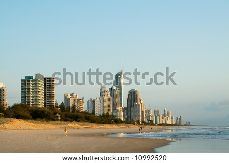 Early morning view of Surfers Paradise skyline on the Gold Coast Australia from the Southern end of the beach. - stock photo