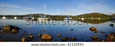 Early morning view of yachts on Lake Windermere in the English Lake District - stock photo
